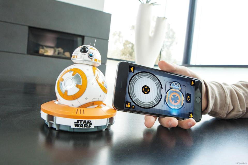 """<p>More a companion than a toy, this playful app-enabled version of the 'Force Awakens' droid shows a range of expressions based on your interactions. Your voice commands trigger it to perk up! (Read the <a href=""""https://www.yahoo.com/tech/star-wars-bb-8-by-sphero-is-the-droid-youre-128259027014.html"""" data-ylk=""""slk:Yahoo Tech review here;outcm:mb_qualified_link;_E:mb_qualified_link;ct:story;"""" class=""""link rapid-noclick-resp yahoo-link"""">Yahoo Tech review here</a>.)<br></p>"""