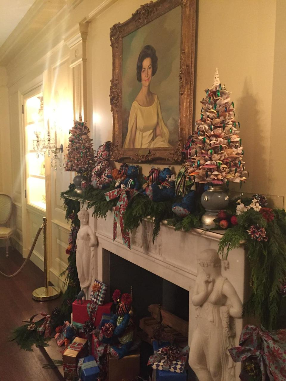 <p>Decorated by Nigerian-born designer Duro Olowu, teddy bears made of vintage fabric share the mantle with trees made of seashells. First lady Lady Bird Johnson's portrait is a focal point of the display. <i>(Photo: Cassie Carothers)</i></p>