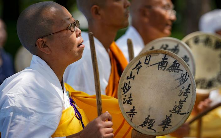 Monks beat hand drums as they pray before the Atomic Bomb Dome in Hiroshima - DAI KUROKAWA/EPA-EFE/Shutterstock /Shutterstock
