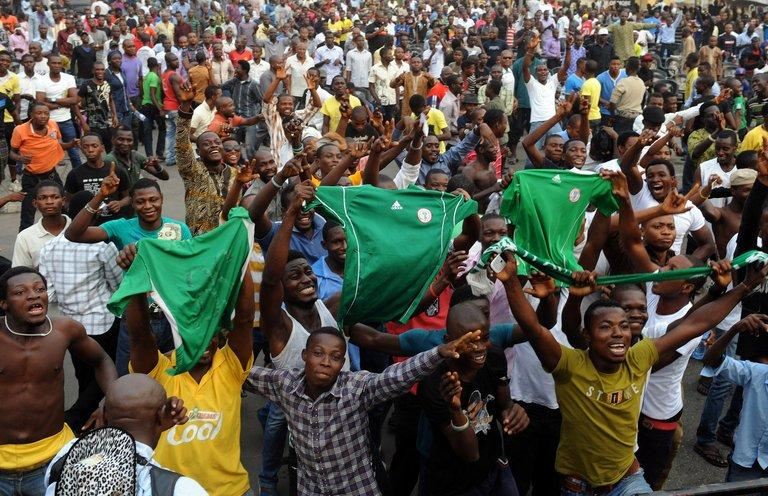 Fans celebrate Nigeria football team's victory over Ivory Coast on February 3, 2013 in Lagos