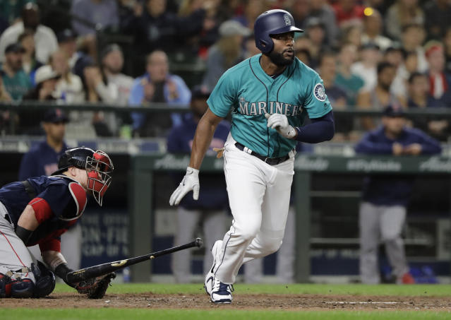 Seattle Mariners' Denard Span heads to first base after he hit a go-ahead two-run double against the Boston Red Sox during the eighth inning of a baseball game Friday, June 15, 2018, in Seattle. The Mariners won 7-6. (AP Photo/Ted S. Warren)