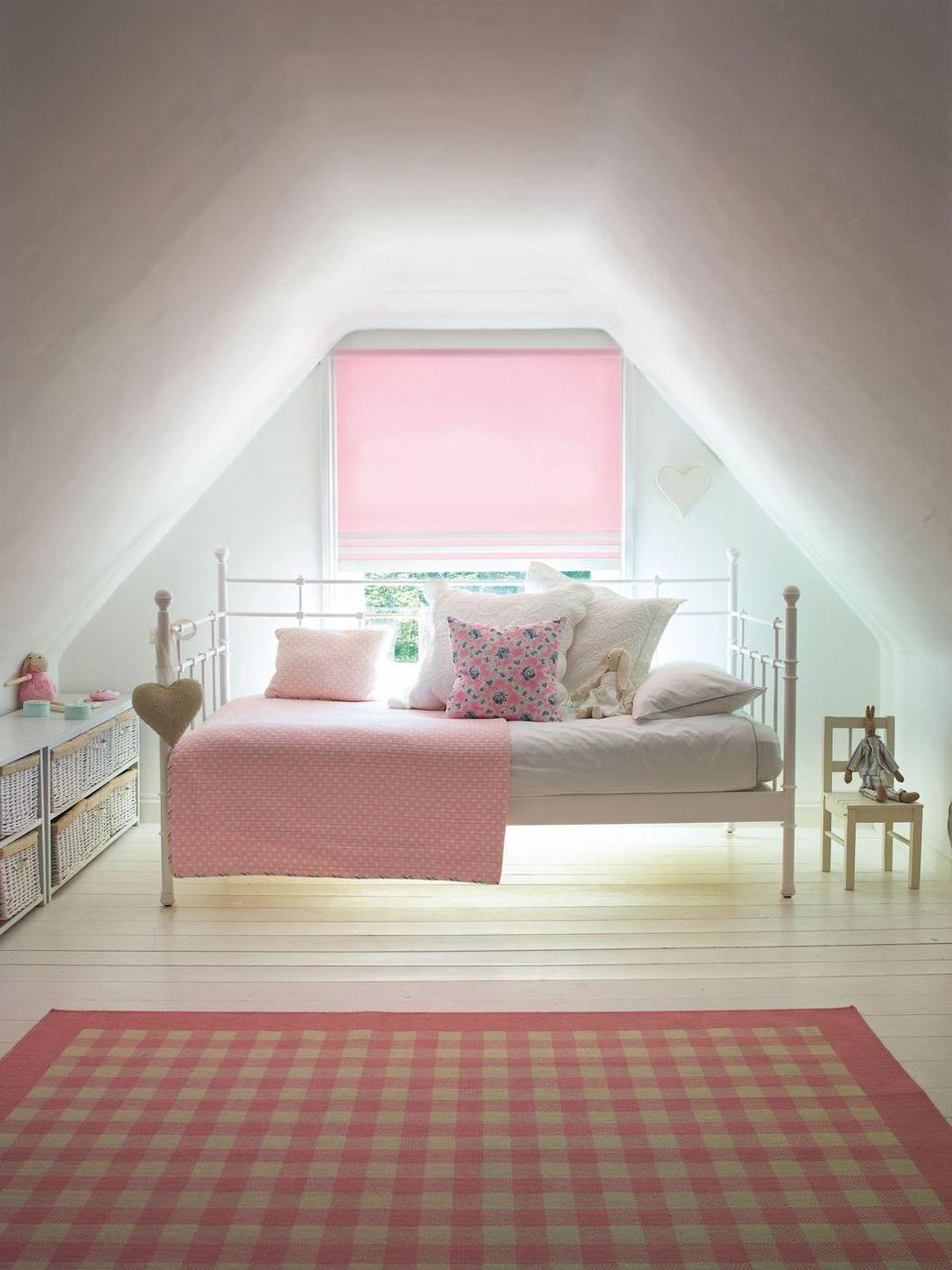 """<p><a href=""""https://www.housebeautiful.com/uk/renovate/build/a1789/rooms-to-consider-renovating-home/"""" rel=""""nofollow noopener"""" target=""""_blank"""" data-ylk=""""slk:Loft extensions"""" class=""""link rapid-noclick-resp"""">Loft extensions</a> make great bedrooms for those who are slightly older – at the top of the house there's a feeling of independence and being slightly away from the parents! Loft bedrooms can be dark though, so opting for white walls and floors can be a great idea, then, what light does come through can be bounced about by the white. Place the bed in the most prominent position and use the lower sides for storage. Add in some pattern with checks, spots and florals and choose a blind to match.</p><p>Pictured: Splash Blush blind, <a href=""""https://www.swiftdirectblinds.co.uk/vertical-blinds/splash-blush-pink/"""" rel=""""nofollow noopener"""" target=""""_blank"""" data-ylk=""""slk:Swift Blinds"""" class=""""link rapid-noclick-resp"""">Swift Blinds</a></p>"""