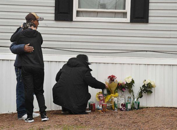 PHOTO: Mourners organize a memorial, May 10, 2021, outside a mobile home in Colorado Springs, Colo., where a shooting at a party took place a day earlier that killed six people before the gunman took his own life. (Jerilee Bennett/The Gazette via AP)