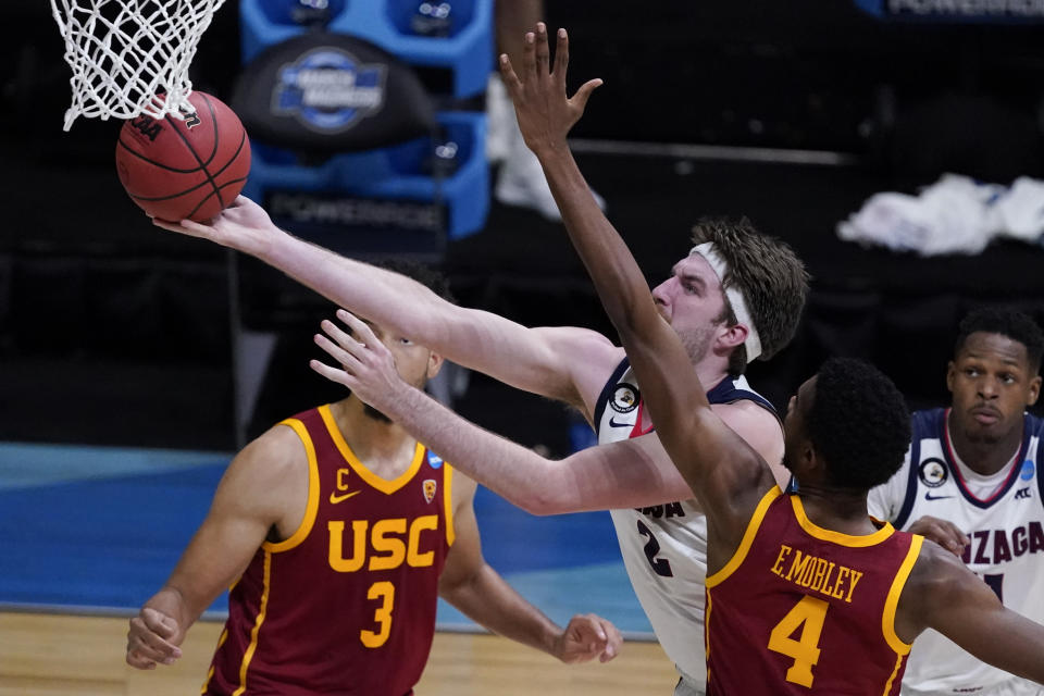 Gonzaga forward Drew Timme drives to the basket ahead of Southern California forward Evan Mobley (4) during the second half of an Elite 8 game in the NCAA men's college basketball tournament at Lucas Oil Stadium, Tuesday, March 30, 2021, in Indianapolis. (AP Photo/Darron Cummings)