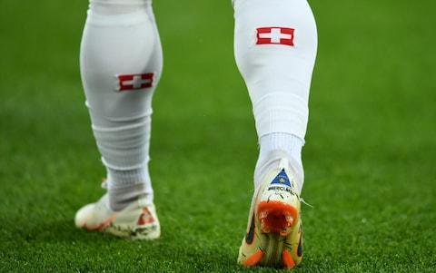 "Serbia want Granit Xhaka and Xherdan Shaqiri punished for their Albanian eagle salutes in the country's defeat in their World Cup grudge match with Switzerland. The Football Association of Serbia (FSS) also announced it would complain to Fifa about Shaqiri's boots - which bears the flag of Kosovo - and the display of ""several controversial flags"" during Friday night's dramatic Group E game in Kaliningrad. And the FSS was lodging an official protest as well about the non-award of a second-half penalty to Aleksandar Mitrovic after the Newcastle United striker was hauled to the ground by two Switzerland defenders. FSS secretary general Jovan Šurbatović said: ""We think we were roughly injured in the 66th minute and we're sure to file a Fifa appeal. ""But that controversial detail in the 66th minute is not the only reason we will write Fifa. The Kosovo flag as seen on Shaqiri's right boot Credit: Getty Images ""This is the case of the boots, it is a question of several controversial flags and it is the celebration of both goals for Switzerland."" Xhaka, whose family was forced to flee the Balkans after his father was jailed for campaigning for Kosovan independence, and Shaqiri, who was born in the former Serbian province, paid tribute to their roots after scoring on Friday. Given both Albania and Kosovo are members of Fifa and their flags displayed at international matches, it appeared unlikely Xhaka and Shaqiri could be charged with breaching its rules on the display of political symbols. But Article 54 of its disciplinary code does outlaw what is defined as ""provoking the general public"", an offence that carries a two-match ban. Stoke City winger Shaqiri admitted afterwards he was overtaken by ""emotion"" after his stoppage-time winner sparked wild celebrations. World Cup 2018 