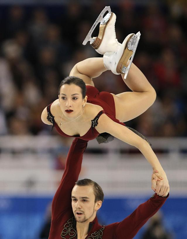 Ksenia Stolbova and Fedor Klimov of Russia compete in the pairs short program figure skating competition at the Iceberg Skating Palace during the 2014 Winter Olympics, Tuesday, Feb. 11, 2014, in Sochi, Russia. (AP Photo/Vadim Ghirda)
