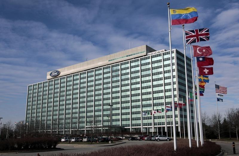 International flags fly along side the U.S. flag in front of the Ford Motor Co. headquarters in Dearborn