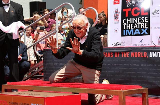 Former Marvel editor-in-chief Stan Lee imprints hands at TCL Chinese Theatre. (Photo: Jacob Kramer/Yahoo)
