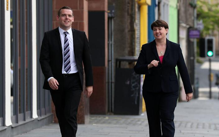 Former Scottish Conservative leader Ruth Davidson MSP alongside Scottish Conservative MP Douglas Ross in Edinburgh, after he confirmed he will stand for leadership of the Scottish Conservatives following the sudden resignation of Jackson Carlaw after less than six months in the post. PA Photo. Picture date: Friday July 31, 2020. Former Scottish Conservative leader and Edinburgh Central MSP Ruth Davidson has agreed to lead First Minister's Questions until a new leader for the party has been elected. See PA story POLITICS ScotTories. Photo credit should read: Andrew Milligan/PA Wire - Andrew Milligan/PA Wire