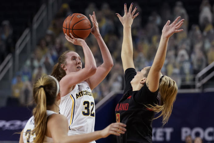Michigan guard Leigha Brown (32) shoots over the defense of Maryland guard Faith Masonius during the first half of an NCAA college basketball game, Thursday, March 4, 2021, in Ann Arbor, Mich. (AP Photo/Carlos Osorio)