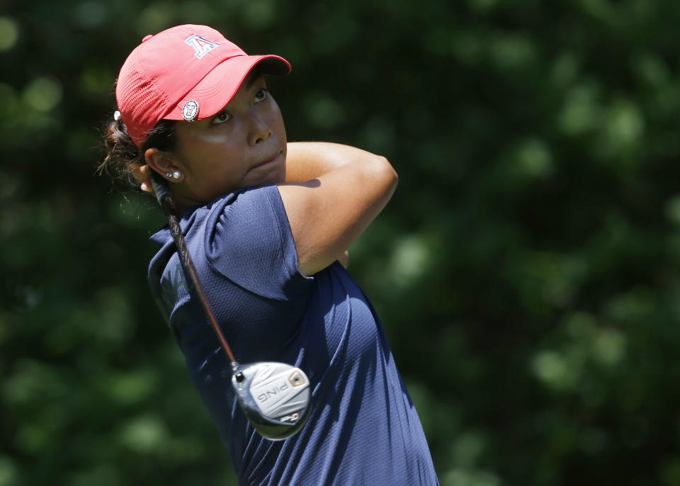 Arizona's Bianca Pagdanganan watches her shot from the fourth tee during the final round of the NCAA Division I Women's Golf Championships in Stillwater, Okla., Wednesday, May 23, 2018. (AP Photo/Sue Ogrocki)