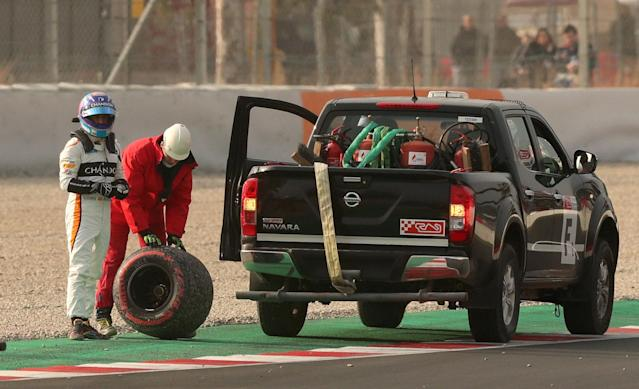 F1 Formula One - Formula One Test Session - Circuit de Barcelona-Catalunya, Montmelo, Spain - February 26, 2018. Fernando Alonso of McLaren looks to the track after losing a rear tyre during testing. Picture taken February 26, 2018. REUTERS/Albert Gea