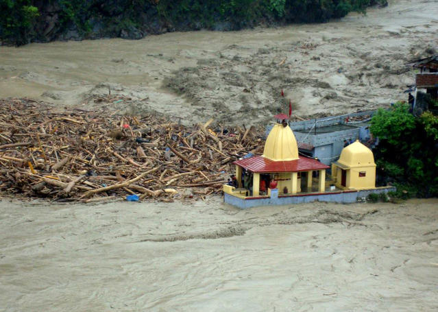 "In this handout photograph released by The Indian Army on June 18, 2013, debris carried by floodwaters of the River Alaknanda crashes against a Hindu Temple in Chamoli district in the northern Indian state of Uttarakhand on June 18, 2013. Torrential rains and flash floods washed away homes and roads in north India, leaving at least feared 60 people dead and thousands stranded, as the annual monsoon hit the country earlier than normal, officials said. Authorities called in military helicopters to try to rescue residents and pilgrims cut off by rising rivers and landslides triggered by more than three days of rain in the Himalayan state of Uttarakhand, officials said. -----EDITORS NOTE---- RESTRICTED TO EDITORIAL USE - MANDATORY CREDIT ""AFP PHOTO / INDIAN ARMY"" - NO MARKETING NO ADVERTISING CAMPAIGNS - DISTRIBUTED AS A SERVICE TO CLIENTS"