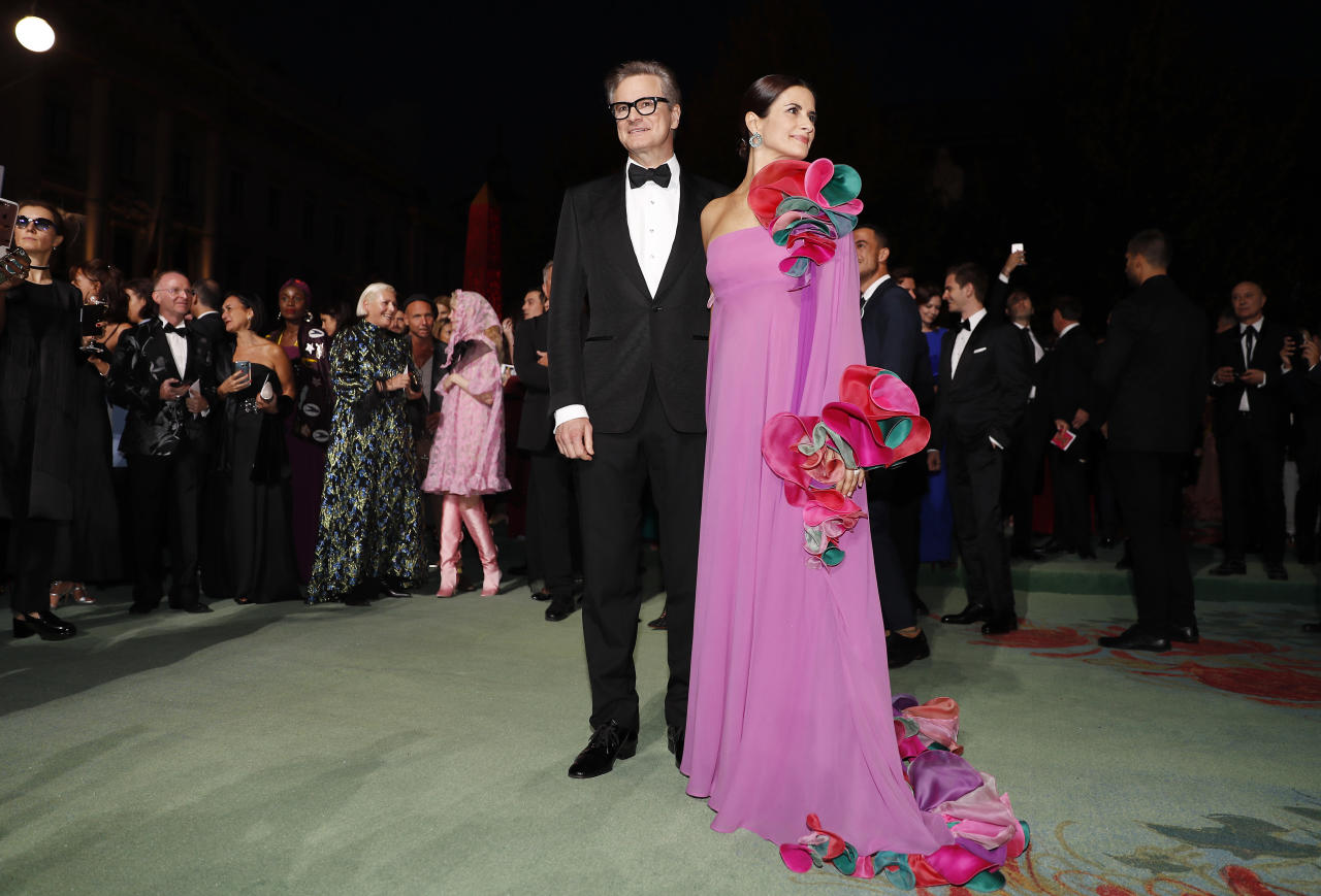 Colin Firth, left, and Livia Firth pose for photographers as they arrive for the Green Carpet Fashion Awards event during the fashion week at the Milan's La Scala theatre, Italy, Sunday, Sept. 24, 2017. (AP Photo/Antonio Calanni)