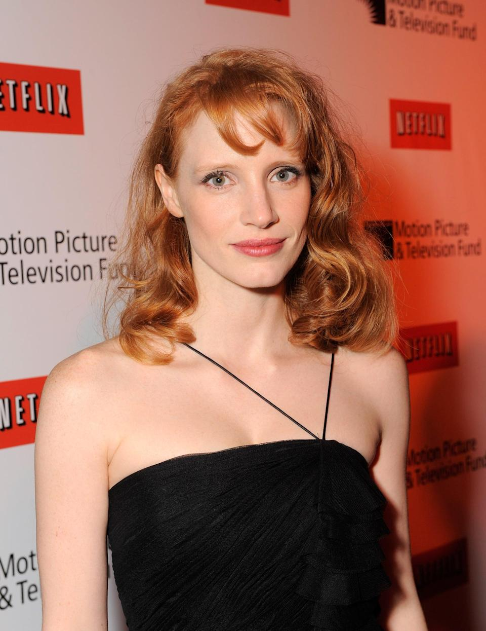 <p>Chastain had loose curls and short, side-swept bangs in 2010.</p>