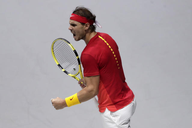 Spain's Rafael Nadal reacts after scoring a point against Canada's Denis Shapovalov during their tennis singles match of the Davis Cup final in Madrid, Spain, Sunday, Nov. 24, 2019. (AP Photo/Bernat Armangue)