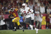 Washington State wide receiver Easop Winston, front, runs toward the end zone past Southern California cornerback Greg Johnson for a touchdown during the first half of an NCAA college football game Friday, Sept. 21, 2018, in Los Angeles. (AP Photo/Jae C. Hong)