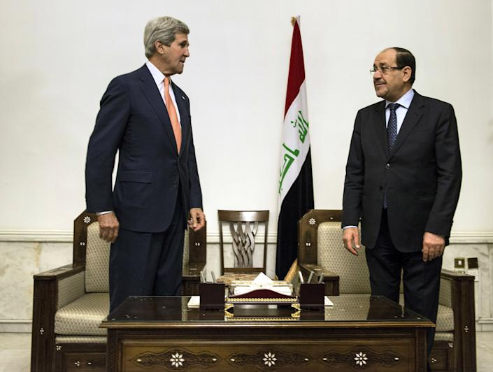 U.S. Secretary of State John Kerry, left, meets with Iraqi Prime Minister Nouri al-Maliki, right, at the Prime Minister's office in Baghdad on Monday, June 23, 2014. Kerry flew to Baghdad on Monday to meet with Iraq's leaders and personally urge the Shiite-led government to give more power to political opponents before a Sunni insurgency seizes more control across the country and sweeps away hopes for lasting peace. (AP Photo/Brendan Smialowski, Pool)