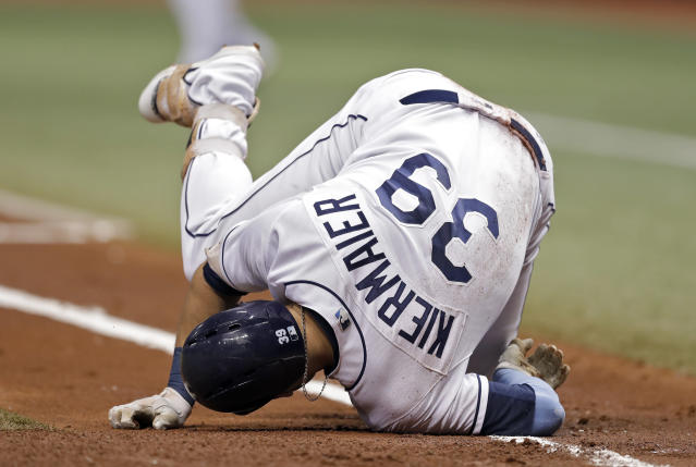 Tampa Bay Rays' Kevin Kiermaier goes down after being hit by a pitch from New York Yankees' Masahiro Tanaka during the first inning of a baseball game Wednesday, Sept. 26, 2018, in St. Petersburg, Fla. (AP Photo/Chris O'Meara)