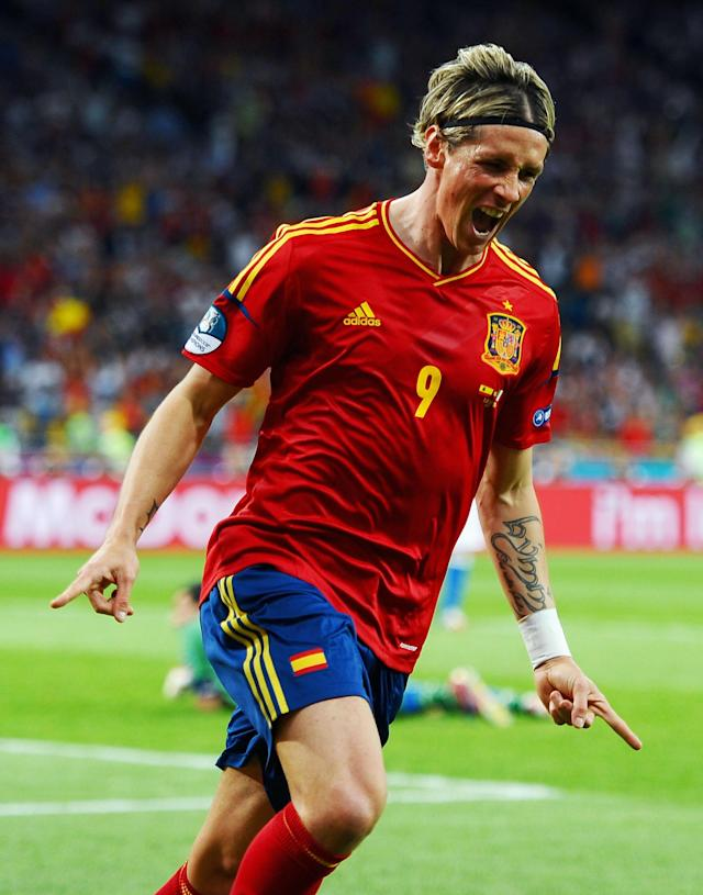 KIEV, UKRAINE - JULY 01: Fernando Torres of Spain celebrates scoring his side's third goal past Gianluigi Buffon of Italy during the UEFA EURO 2012 final match between Spain and Italy at the Olympic Stadium on July 1, 2012 in Kiev, Ukraine. (Photo by Laurence Griffiths/Getty Images)