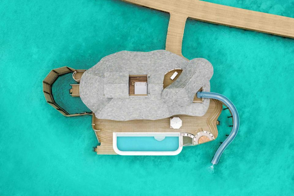 Aerial shot of a villa with a slide at Soneva Fushi, voted one of the best hotels in the world