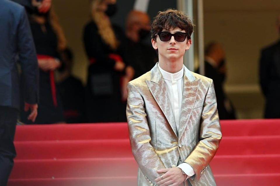 """<ul> <li><strong>What to wear: </strong>The <a href=""""https://www.popsugar.com/fashion/timothee-chalamet-silver-suit-cannes-2021-48414518"""" class=""""link rapid-noclick-resp"""" rel=""""nofollow noopener"""" target=""""_blank"""" data-ylk=""""slk:actor's Cannes Film Festival red carpet debut"""">actor's Cannes Film Festival red carpet debut</a> was one we can't stop thinking about, OK? Timothée opted for a silver suit covered in a subtle zebra pattern, and whew, what a style moment. To copy this outfit, pick yourself up a silver suit and accessories with black shades. Bonus points if you happen to find a silver suit in a zebra pattern! </li> </ul>"""