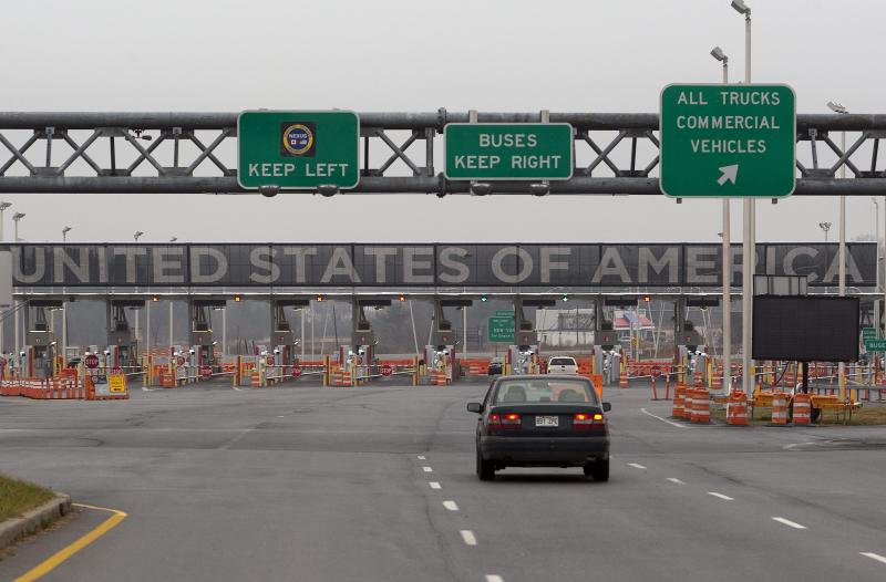 FILE - In this Wednesday, Dec. 7, 2011 file photo, a car approaches the United States and Canada border crossing in Lacolle, Quebec, south of Montreal. In April 2013, in its 2014 fiscal year budget proposal, the Department of Homeland Security requested permission to study a fee at the nation's land border crossings. The request has sparked wide opposition among members of Congress from northern states, who vowed to stop it. A fee, they say, would hurt communities on the border that rely on people, goods and money moving between the U.S. and Canada. (AP Photo/The Canadian Press, Ryan Remiorz, File)