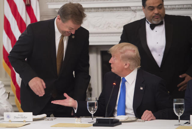 President Trump welcomes Sen. Dean Heller before a meeting with Republican senators to discuss the health care bill, July 19, 2017. (Photo: Saul Loeb/AFP/Getty Images)