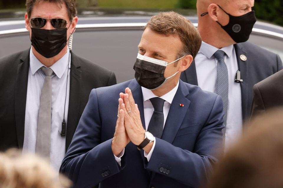 The French president, Emmanuel Macron, casts his vote at a polling station in Le Touquet on Sunday in the first round of the French regional elections (AFP via Getty Images)