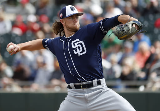 San Diego Padres pitcher Chris Paddack throws against the Oakland Athletics during the first inning of a spring training baseball game, Friday, March 8, 2019, in Mesa, Ariz. (AP Photo/Matt York)