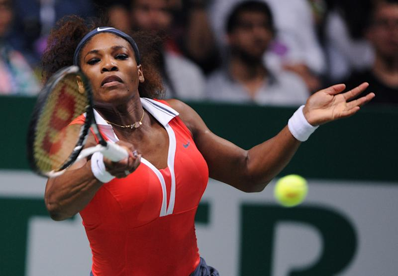 Serena Williams of the US returns a shot to Maria Sharapova of Russia during their final tennis match of the WTA Championships in Istanbul, Turkey, Sunday, Oct. 28, 2012. (AP Photo)