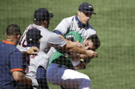 Oakland Athletics' Ramon Laureano is restrained by Houston Astro's Dustin Garneau after Laureano charged the dugout after being hit by a pitch thrown by Humberto Castellanos in the seventh inning of a baseball game Sunday, Aug. 9, 2020, in Oakland, Calif. (AP Photo/Ben Margot)