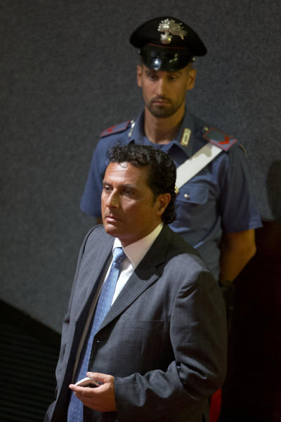 Captain Francesco Schettino arrives in the court room of the converted Teatro Moderno theater for the start of his trial, in Grosseto's Teatro Moderno, Italy, Wednesday, July 17, 2013. The trial of the captain of the shipwrecked Costa Concordia cruise liner, accused of multiple manslaughter, abandoning ship and causing the shipwreck near the island of Giglio, has begun in a theater converted into a courtroom in Tuscany to accommodate all the survivors and relatives of the 32 victims who want to see justice carried out in the 2012 tragedy. The trial, which was supposed to get under way July 9, was postponed until Wednesday due to a lawyers' strike. (AP Photo/Andrew Medichini)