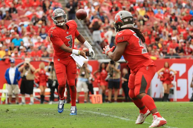 <p>Jameis Winston #3 of the Tampa Bay Buccaneers throws a pass to Jacquizz Rodgers #32 during the third quarter at Raymond James Stadium on December 09, 2018 in Tampa, Florida. (Photo by Mike Ehrmann/Getty Images) </p>