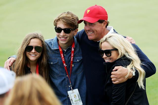 """<h1 class=""""title"""">The Presidents Cup - Round Three</h1> <div class=""""caption""""> JERSEY CITY, NJ - SEPTEMBER 30: Phil Mickelson of the U.S. Team and his family, wife Amy, son Evan and daughter Sophia pose during Saturday four-ball matches of the Presidents Cup at Liberty National Golf Club on September 30, 2017 in Jersey City, New Jersey. (Photo by Rob Carr/Getty Images) </div> <cite class=""""credit"""">Rob Carr</cite>"""