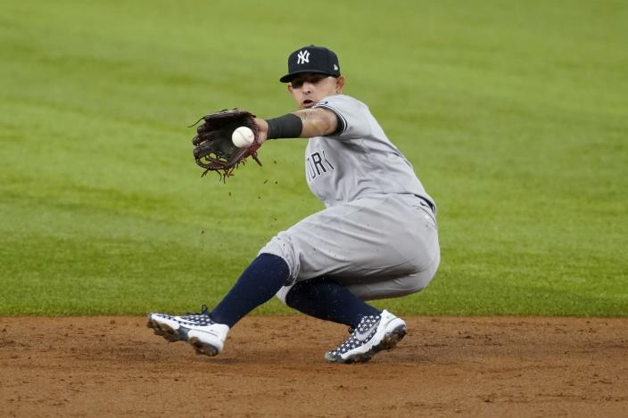 New York Yankees second baseman Rougned Odor fields a double play ball in the second inning of a baseball game in Arlington, Texas, Tuesday, May 18, 2021. The Rangers' David Dahl was forced at second on the play. (AP Photo/Tony Gutierrez)