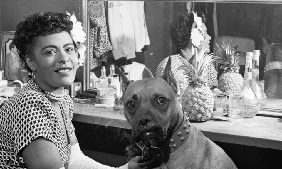 Billie Holiday with her dog, Mister, in June 1946.