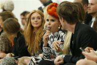 Singer Paloma Faith eats a lollipop before the Matthew Williamson Spring/Summer 2014 collection presentation during London Fashion Week September 15, 2013. REUTERS/Suzanne Plunkett