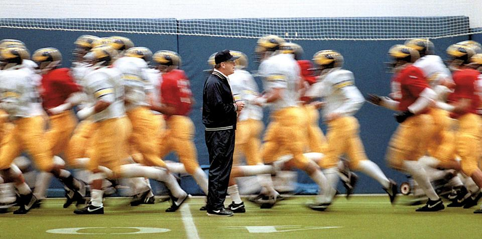 Bo Schembechler with his Michigan football players during practice in October, 1986 in Ann Arbor, before the game where he earned his 200th career victory.
