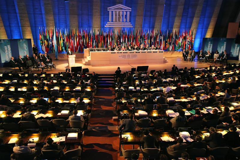 FILE - This Wednesday, Nov. 6, 2013, file photo shows a general view of the 37th session of the General Conference of UNESCO in Paris, France. American influence in culture, science and education around the world will take a high-profile blow on Friday as the US is stripped of its vote at the world's premier cultural agency, UNESCO. The U.S. loses its vote at the Paris-based U.N. Educational, Scientific and Cultural Organization following Washington's decision in 2011 to cut all funding to the U.N. agency over the vote giving Palestine member-state status. (AP Photo/Michel Euler, file)
