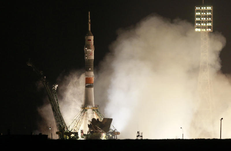 The Soyuz-FG rocket booster with Soyuz TMA-20 space ship carrying a new crew to the International Space Station, ISS, blasts off from the Russian leased Baikonur cosmodrome, Kazakhstan, Thursday, Dec. 16, 2010. The Russian rocket carries U.S. astronaut Catherine Coleman,  Russian cosmonaut Dmitry Kondratiev,  and Italian astronaut Paolo Nespoli. (AP Photo/Dmitry Lovetsky)