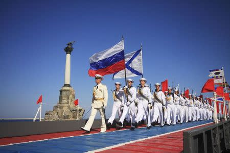 Russian sailors march during celebrations to mark Navy Day in the Crimean port of Sevastopol July 27, 2014. REUTERS/Stringer