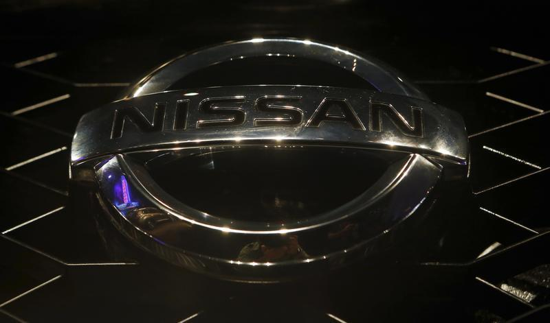"A company logo is seen on the newly-unveiled Nissan ""Terrano"" compact sport utility vehicle during a news conference in Mumbai"