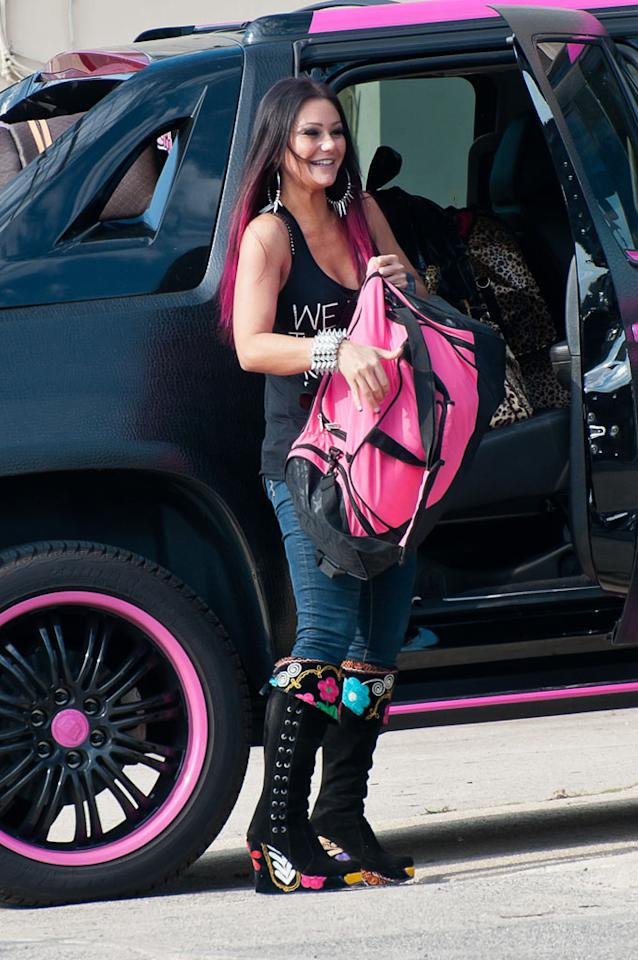 "Jenni ""JWoww"" Farley, was all smiles upon stepping out of her BFF Snooki's tacky pink-and-black Cadillac Escalade truck. (5/31/2012)"