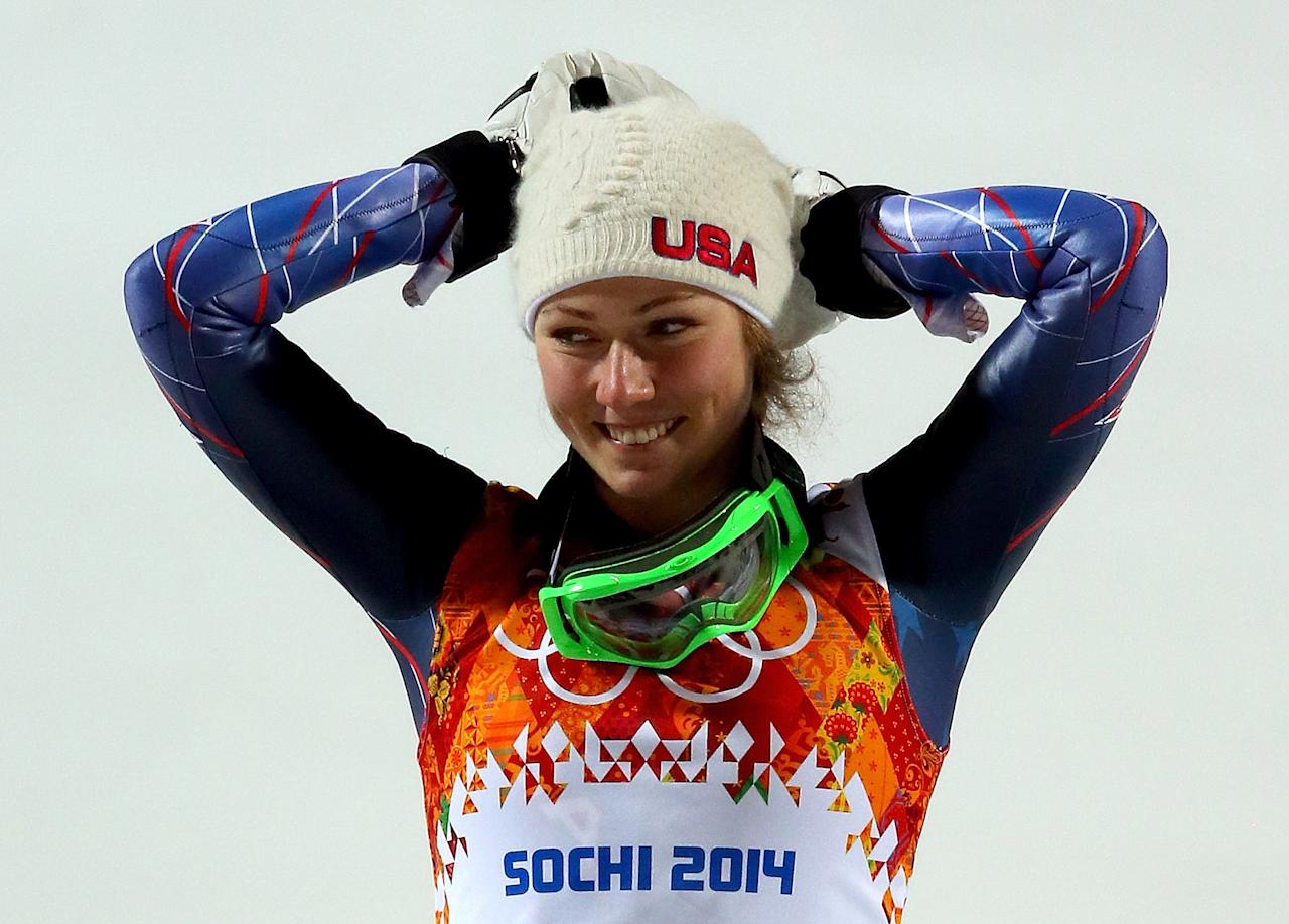 SOCHI, RUSSIA - FEBRUARY 21: Gold medalist Mikaela Shiffrin of the United States celebrates during the flower ceremony for the Women's Slalom during day 14 of the Sochi 2014 Winter Olympics at Rosa Khutor Alpine Center on February 21, 2014 in Sochi, Russia. (Photo by Alexander Hassenstein/Getty Images)