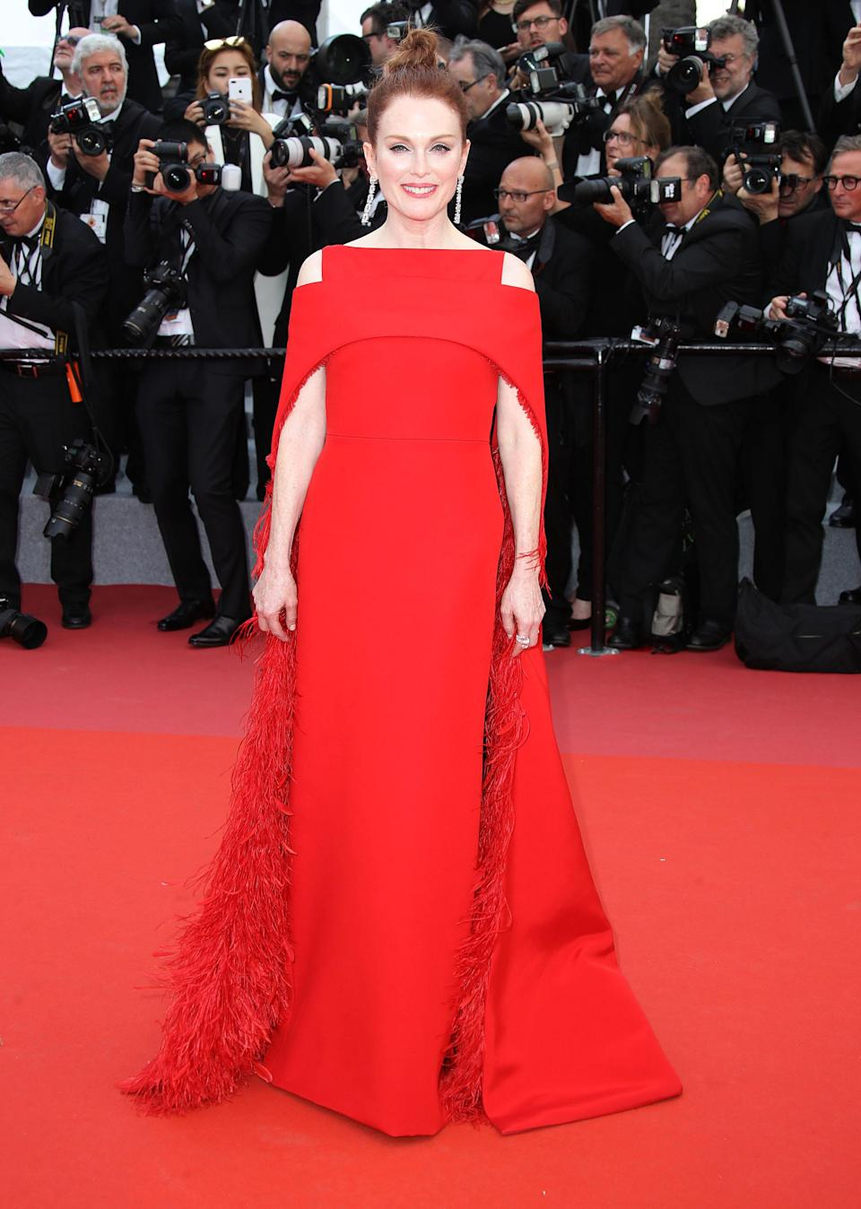 <p>Julianne stunned in a Givenchy Haute Couture red cape gown, a go-to shape for the actress. <em>[Photo: Getty]</em> </p>