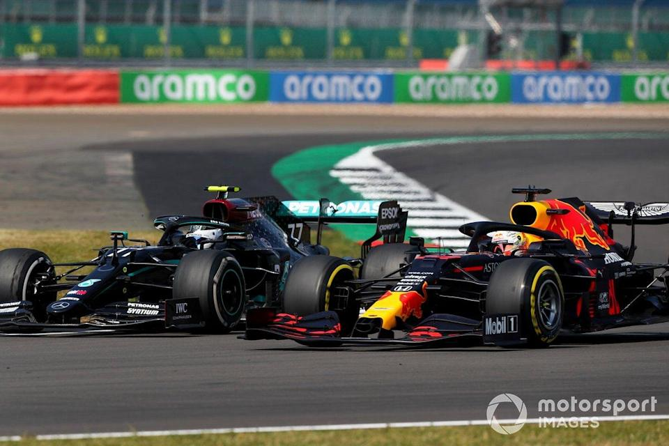 "Valtteri Bottas, Mercedes F1 W11 and Max Verstappen, Red Bull Racing RB16 battle for the lead of the race<span class=""copyright"">Charles Coates / Motorsport Images</span>"