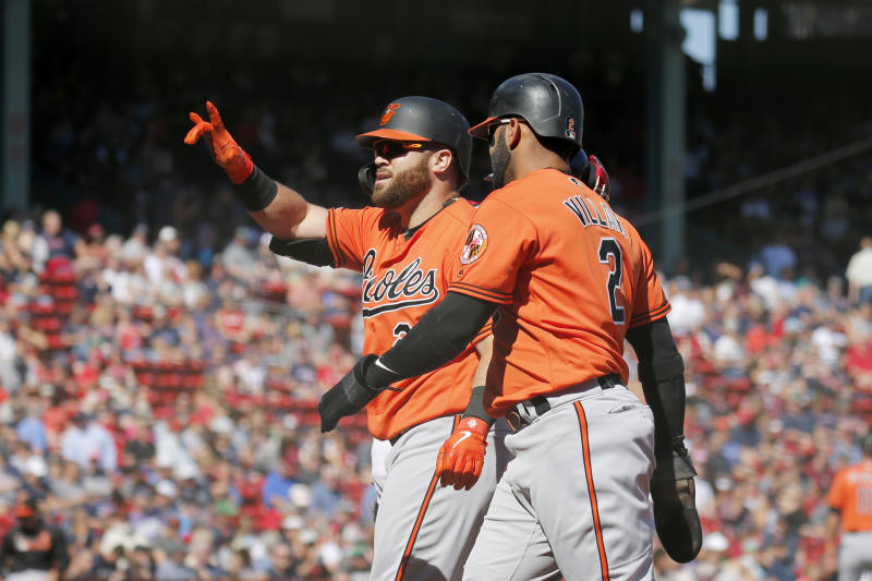 Baltimore Orioles' DJ Stewart (24) celebrates with teammate Jonathan Villar after hitting a two-run home run scoring Villar during the first inning of a baseball game against the Boston Red Sox, Saturday, Sept. 28, 2019, in Boston. (AP Photo/Mary Schwalm)
