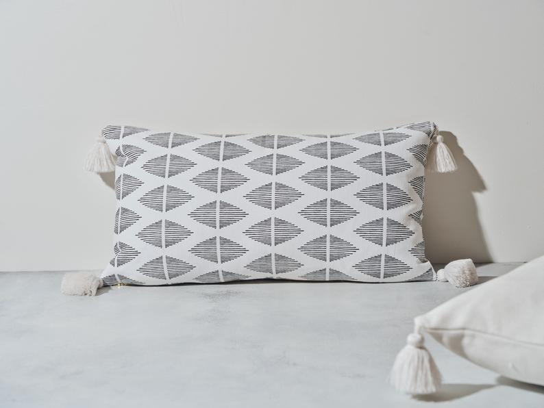 """<p><strong>Chloe and Olive Pillows</strong></p><p>etsy.com</p><p><strong>$166.00</strong></p><p><a href=""""https://go.redirectingat.com?id=74968X1596630&url=https%3A%2F%2Fwww.etsy.com%2Flisting%2F844520915%2Ftia-mowry-x-etsy-geo-tassel-lumbar-throw&sref=https%3A%2F%2Fwww.townandcountrymag.com%2Fleisure%2Fg37191699%2Ffall-bedroom-decor%2F"""" rel=""""nofollow noopener"""" target=""""_blank"""" data-ylk=""""slk:Shop Now"""" class=""""link rapid-noclick-resp"""">Shop Now</a></p><p>This cozy geometric throw pillow is part of Tia Mowry's new curated collection on Etsy, which features stylish monochrome home decor and highlights some of the site's best Black creators. </p>"""