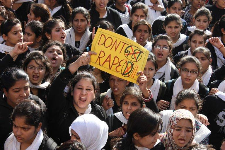 Indian students shout slogans as they wave a placard during a demonstration in Jammu on December 20, 2012, as they protest the rape of a young woman in the Indian capital